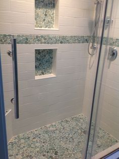 Large sliced sea green pebble tile shower floor and niche - built-in shelves cool Pebble Tile Shower Floor, Subway Tile Showers, Pebble Tiles, White Tile Shower, Bathroom Showers, White Tiles, Tile Floor, Douche Design, Shower Tile Designs