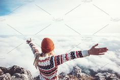 Happy woman traveler over clouds. People Photos