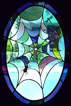 The window is composed of hand blown glass and is located in the front door of a stunning Victorian home.(Daniel Maher Stained Glass - Spiderweb)