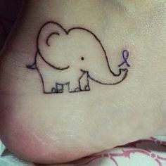 First Tattoo, my grandma has Alzheimer's so the ribbon is purple and the elephant is because Elephants Never Forget