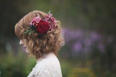 bride with curly hair with loose flowers pinned
