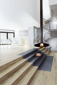 Timber Stairs and suspended fireplace