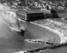 The hulk of the Morro Castle, still smoking from a fire that killed 137 people, becomes a morbid tourist attraction in 1934 off Asbury Park, N. Iconic Photos, Old Photos, Abandoned Ships, Asbury Park, Ellis Island, Water Tower, Shipwreck, Historical Pictures, Beach Images