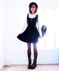 Bernadette F. - Shirt, Cross Beaded Necklace, Velvet Skater Dress, Studded Backpack, Boots