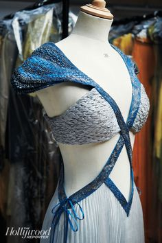 Mother of Dragons Daenerys Targaryen's Costume. Simulated dragon scales grow thicker as her power increases.