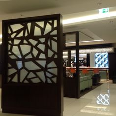 A number of these decorative glass panels define the walkway in the Etihad Lounge at the Abu Dhabi airport. The strategically placed panels guide the pedestrian to various sections of the lounge without intruding on others using the various spaces. The decorative pattern also reflects a modern take on the traditional use of pattern in Arabic interiors, while the glass gives a lightness to the structures.