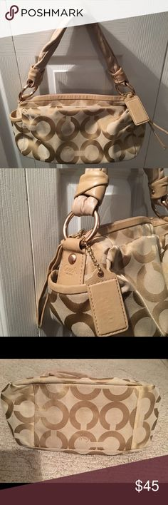 COACH TAN GOLD SATCHEL LEATHER GORGEOUS! SIGNATURE AUTHENTIC COACH SATCHEL IN BEAUTIFUL CONDITION. ZOOM IN ON PICS FOR DETAILS. ONLY MARK I SEE IS INSIDE LINING BOTTOM OF BAG AS SHOWN IN PIC.    REASONABLE OFFERS CONSIDERED. NO TRADES PLEASE! Coach Bags Satchels