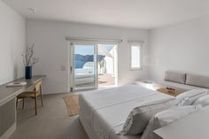 The hotel is located on the edge of the traditional village of Oia, at the top of the Caldera volcanic rocks. The plot has a steep ground slope,. The Saint, Hotel Grecia, Hostels, Santorini Hotels, Santorini Greece, Hotel Villas, Interior Architecture, Interior Design, Massage Room