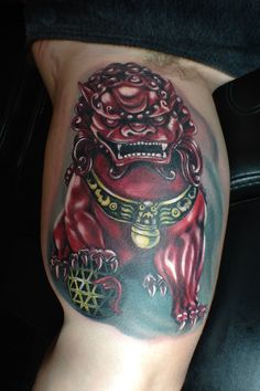 Shisa color bicep tattoo by Monte Livingston at Living Art Gallery Tattoo in San Clemente, CA. www.sclivingartgallery.com #montelivingston #livingartgallery #shisatattoo
