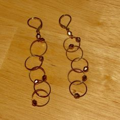 Bronze & Gold Dangles Connected circle dangles with lever back closure. These are a bronze/gold color! Charlotte Russe Jewelry Earrings