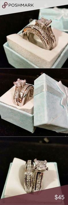 Gorgeous cz diamond wedding ring set size 8 Gorgeous cz diamond wedding ring set size 8 Absolutely stunning  Center stone is over 2 ct Silver and Rhodium Size 8 Jewelry Rings