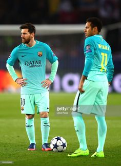 Lionel Messi and Neymar of Barcelona look on during the UEFA Champions League Round of 16 first leg match between Paris Saint-Germain and FC Barcelona at Parc des Princes on February 14, 2017 in Paris, France.
