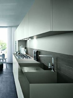 This sleek and stylish kitchen was completed by Italkraft. #luxeFL
