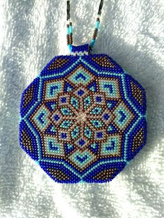 This medallion is done wih size 15 beads . The necklace has dna style beadwork. Alot of time invested into this and done very well. This done by a native american from in montana.