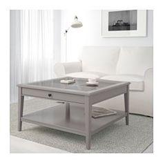 IKEA - LIATORP, Mesa de centro, blanco/vidrio, , Almacenaje práctico en la mesa.Con una balda para guardar revistas, etc., que te ayuda a tener tus cosas ordenadas y a despejar el tablero de la mesa.
