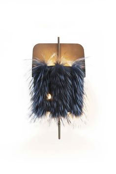 Designed in a sophisticated and luxurious version covered with fur on the exterior, the Velum lamps recall the Fur Tabletsthat had Karl Lagerfeld's design