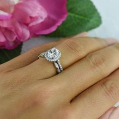 Modern yet romantic, honor the one you love with this stunning halo set.  Each…