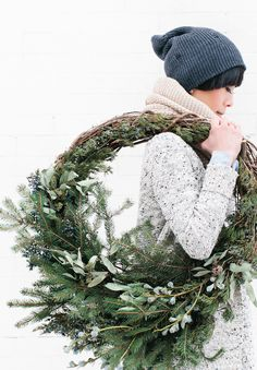 Great idea for a winter wreath. Load up one side with greens, leave the other side a bit more sparse.