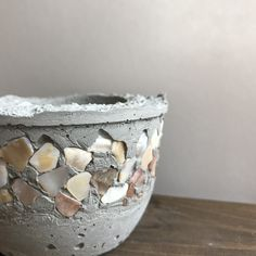 cute gray concrete planter pot round with a ring of mother of pearl shells around the top handmade for succulents flowers and plants Concrete Plant Pots, Cement Flower Pots, Concrete Planters, Concrete Garden, Cement Art, Concrete Crafts, Concrete Projects, Papercrete, Concrete Sculpture