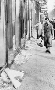 Glass covers the streets after Kristallnacht • 910 November 1938