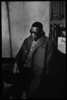 RAY CHARLES (1960) Marshall is most famous for his iconic photographs of such rock stars as Jimi Hendrix and the Rolling Stones. But he also shot many jazz and soul musicians, including Ray Charles who is pictured here relaxing prior to playing a show. Image from the book Match Prints by Jim Marshall and Timothy White