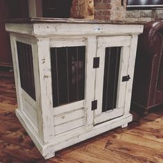 Urban farmhouse design!  Distressed antique white paint from sherwin Williams.  Medium indoor dog kennel.  Replace your wire crate.  It's furniture for your dog.  Customize yours with a vintage look with reclaimed lumber or wrap it in steel for an industrial design.  We call that the gridiron feature.  Check out all the possibilities!