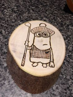 Pyrography golfer Minion that Evie has made for Gam