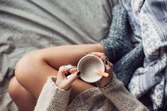 Woman Drinking Hot Coffee in Bed in the Morning by lumina | Stocksy United