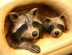 Image result for raccoon wood carving
