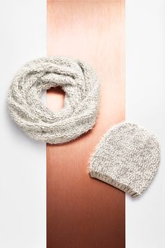 Infinity + beyond. Snuggle into the boucle knit infinity scarf + beanie for her.