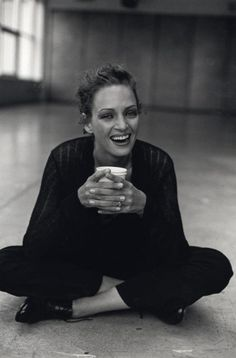 Uma Thurman drinking coffee