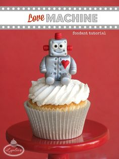 Make your valentine's heart go beep with this sweet Love Machine fondant robot cupcake topper tutorial!