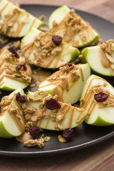 Drizzle apple nachos with warm peanut butter and top with granola and dried fruit for a dreamy healthy snack.    Get the recipe from Delish.   - Redbook.com