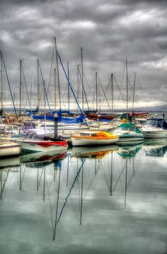 I Love this! This is what great photos are made of.  A little splash of colour A splash of colour from these yachts on Phillip Island on an otherwise very very grey day. No selective colouring here, it was just a grey grey day. from http://365project.org/clarek/365/2012-02-27.
