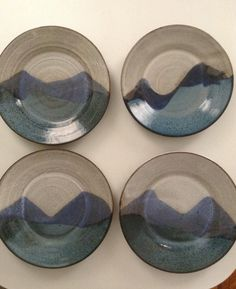 Set of 4 serving dishes with mountain motif in by BarroYagua, $100.00