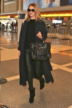 Chic traveller: Rosie Huntington-Whiteley arrives at LAX airport to catch a flight on Tues...