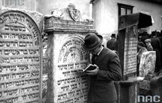 Feast of the of Rabbi Remuh on the Remuh Cemetery in Krakow (May 1931).. Participants of the ceremony in prayer at the graves.