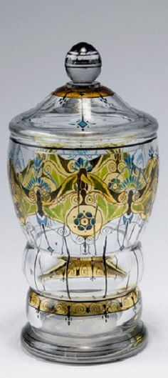 Haida-Steinschoenau. Covered goblet, c1915-20. H. 21.5 cm. Clear glass. Enamel, grisaille paint, stained yellow. Stylized floral pattern.