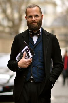 This gentleman, seen on the streets of Paris during fashion week, could easily be my fashion guru.  Retro needs to step it up a notch and head back to the 1800s.