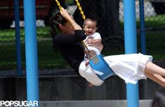 Happy Birthday, Maddox — See the Sweetest Jolie-Pitt Moments!: Angelina Jolie and Maddox spent a sweet day swinging at a park in Santa Monica, CA, in July 2002.