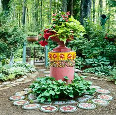 'Illumination Scarlet' begonias and chartreuse sweet-potato vine burst out of an urn sitting on a pedestal made from painted septic-tank collars rimmed with beads and fused-glass flowers and encircled by mosaic stepping-stones. The gate in the distance was formerly a fireplace screen.  #garden #gardendesign #gardendecor #homeimprovement #artfulgarden #gardentour #gardeninspiration #gardenideas Garden Design Images, Landscape Design, Most Beautiful Gardens, Amazing Gardens, Mosaic Stepping Stones, Potato Vines, Vintage Planters, Rustic Flowers, Scarlet