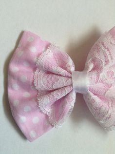 Baby pink polka dot hair bow with Lace overlay centre