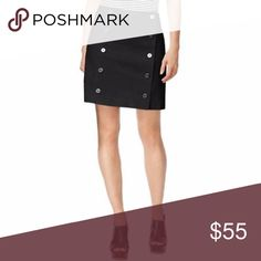 """NWT Michael Kors Black A-Line Mini Button Skirt Super cute Michael Kors skirt in black with silver buttons.  A fully lined, A-Line mini skirt style.  No stretch.   Brand new with tags.  97% Cotton 3% Elastane  14"""" Waist 17"""" Long Michael Kors Skirts A-Line or Full"""