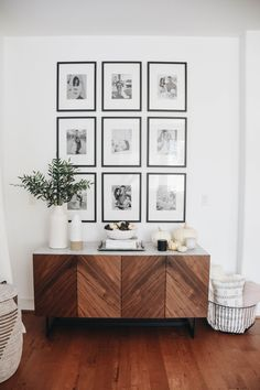 modern farmhouse foyer design with herringbone buffet with grid wall gallery wit. modern farmhouse foyer design with herringbone buffet with grid wall gallery with black and white photos, modern farmhou. Gallery Wall Frames, Frames On Wall, Modern Gallery Wall, Photo Frame Walls, Modern Farmhouse Gallery Wall, Framed Wall, Art Gallery, Boho Living Room, Living Spaces
