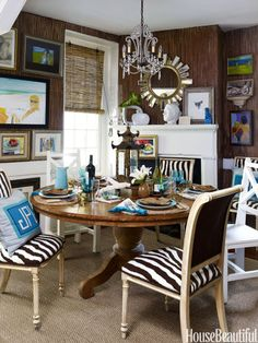 The zebra pattern on the dining room chairs was designed by Gregg and executed in needlepoint by her mother.