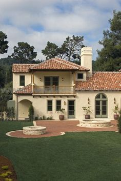 Stock Photo titled: Exterior Of A SPANISH STYLE LUXURY HOME With Stucco Walls And Red Tile Roof, unlicensed use prohibited