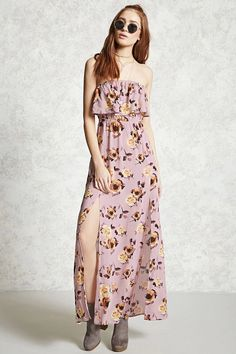 A woven strapless maxi dress featuring an allover floral print, a flounce layer at the bust, an elasticized waist, and side slits.