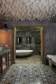 Capiz chandelier + the tile + that bathtub = simply glorious. I love this.