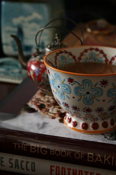 """I love this teacup!! Decorated inside as well as outside, gorgeous..."" And the Tibetan teapot behind it is pretty amazing too... and the rest of the stuff. :-)"