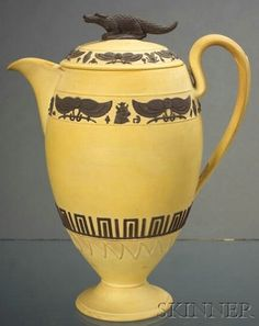 WEDGWOOD Caneware Egyptian Hot Water Pot and Cover, England, early 1800's, applied chocolate brown relief with a band of hieroglyphs above a meander banding, the cover with hieroglyphs surrounding a crocodile finial, impressed mark, ht. 8 1/2 in.      SOLD $4,113 Skinner Auction